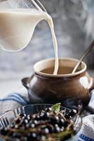 hälla mjölk foto