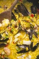 matlagning paella foto