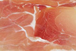 närbild foto av italiensk prosciutto