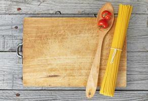 pasta spagetti sked tomater foto