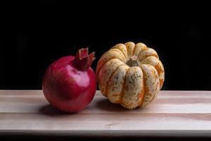 squash och granatäpple foto