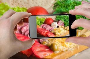matfoton på smartphone foto