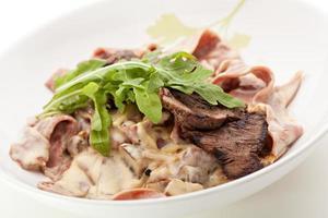 pasta med kött foto