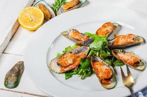 musslor med parmesan foto
