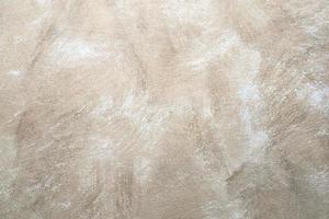 rock abstrakt beige vägg bakgrund foto