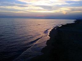 havssolnedgång, sommar foto
