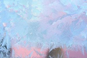frost på vinterfönstret foto