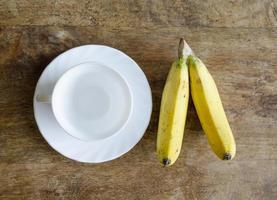 kaffekopp och banan foto