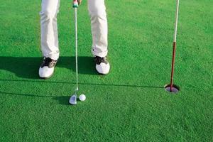 golf på greenen foto