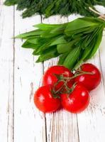 tomater och ramson foto