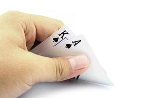 svart jack kort spade i handen foto