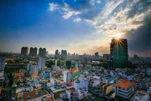ho chi minh stad i solnedgången foto