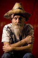 gammal man med hatt och skägg foto
