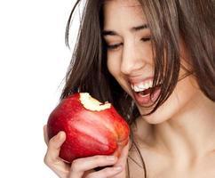 kvinnligt rött bitit äpple foto