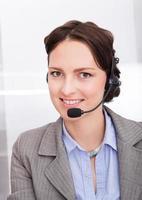 kvinnlig telefonoperatör foto