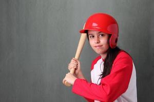 ung kvinnlig basebollspelare foto