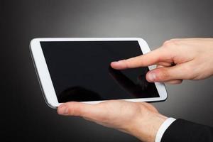 affärsman som använder digital surfplatta foto