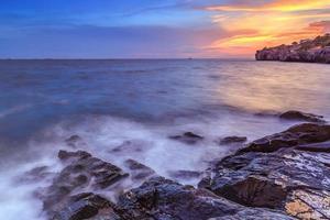 solnedgång vid havet foto