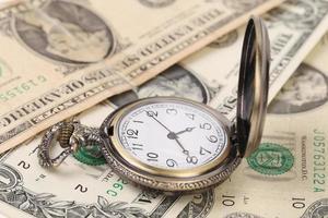 tid - pengar. foto