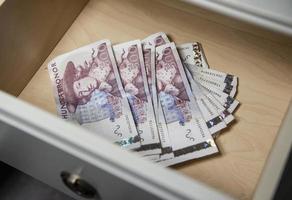 pengar i lådan foto