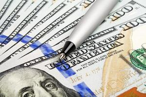 affärsidé - pengar och penna foto