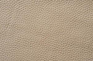 närbild av sömlös beige läder textur foto