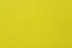 närbild av sömlös gul läder textur foto