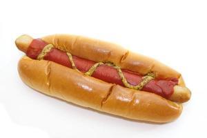 aptitretande takeaway hotdog med senap och ketchup foto
