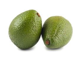två gröna avokado foto