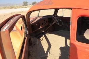 schrottautos i namibia foto