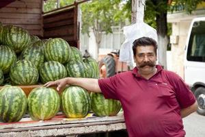 säljer vattenmeloner, rättvis handel foto
