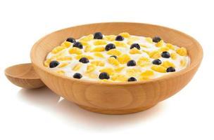 majsflingor i skål på vit foto