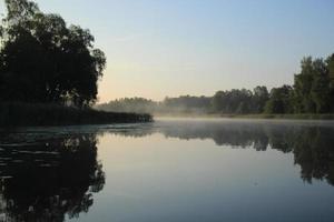 sjön gryning foto
