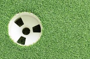 kopp golfklubb och gräs foto