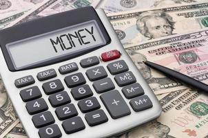 miniräknare med pengar - pengar foto