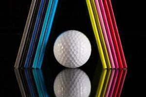 tolv olika färger dagböcker och golfboll foto