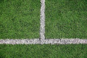 grön fotbollsplan detaljbakgrund foto