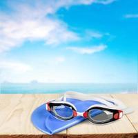 simning, simglasögon, mössa foto