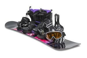 snowboard med bagage, handskar och glasögon foto