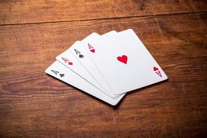 grupp med fyra spelkort-ess foto