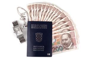 kroatiska pass med värdesaker foto