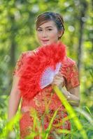 asiatisk flicka i traditionell kinesisk klänning.42 foto