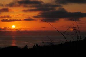 solnedgång, månuppgång foto