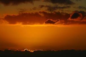 solnedgång moln foto