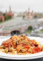 stekt musslor med pasta foto