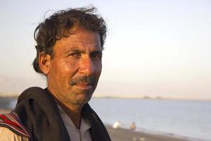 porträtt av en baloch fiskare foto