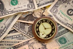 tid och pengar foto