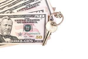 pengar och nyckel foto