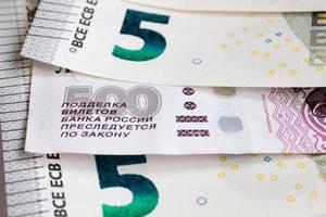 euro och ryska pengar foto