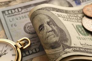 tid och pengar. guld ton. närbild foto